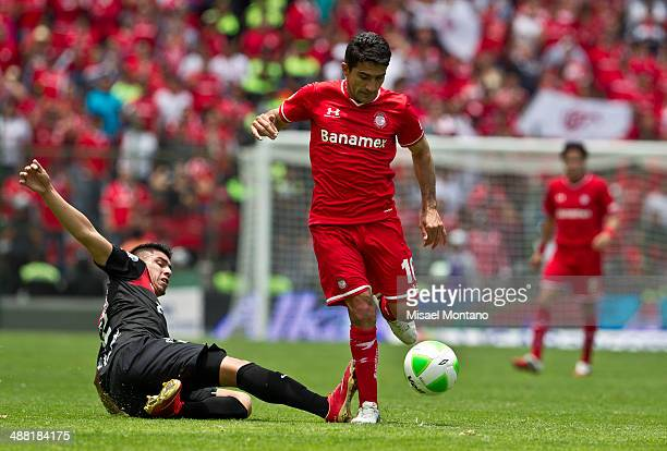 Antonio Naelson of Toluca fights for the ball with Javier Güemez of Tijuana during the Quarterfinal second leg match between Toluca and Xolos de...