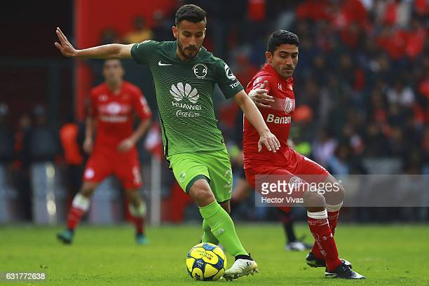 Antonio Naelson of Toluca struggles for the ball with Jose Guerrero of America during the 2nd round match between Toluca and America as part of the...
