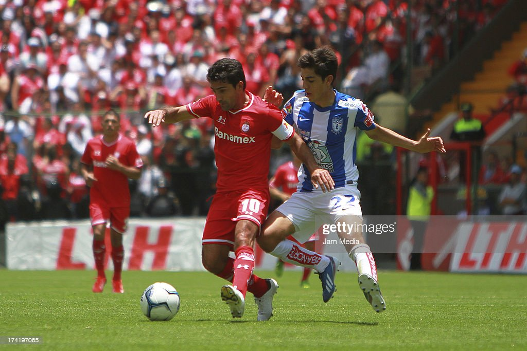 Antonio Naelson (R) of Toluca struggles for the ball with Rodolfo Pizarro (L) of Tijuana during the match between Toluca and Pachuca as part of the Apertura 2013 Liga Bancomer MX at Nemesio Diez Stadium on july 21, 2013 in Toluca, Mexico.