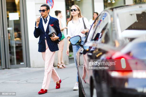 Antonio Nieto wears sunglasses a blazer jacket a scarf a white shirt pink pants and red shoes outside the Hermes show during Paris Fashion Week...