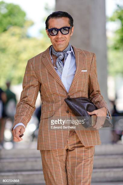 Antonio Nieto wears sunglasses a suit and a scarf outside the 22/4 Hommes show during Paris Fashion Week Menswear Spring/Summer 2018 on June 23 2017...