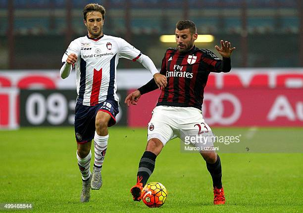 Antonio Nocerino of AC Milan competes for the ball with Andrea Barberis of Eloge Koffi Guy Yao during the TIM Cup match between AC Milan and FC...