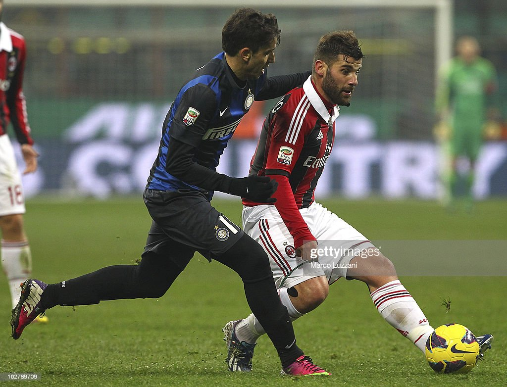 Antonio Nocerino (R) of AC Milan competes for the ball with Gabriel Ricardo Alvarez (L) of FC Internazionale Milano during the Serie A match FC Internazionale Milano and AC Milan at San Siro Stadium on February 24, 2013 in Milan, Italy.