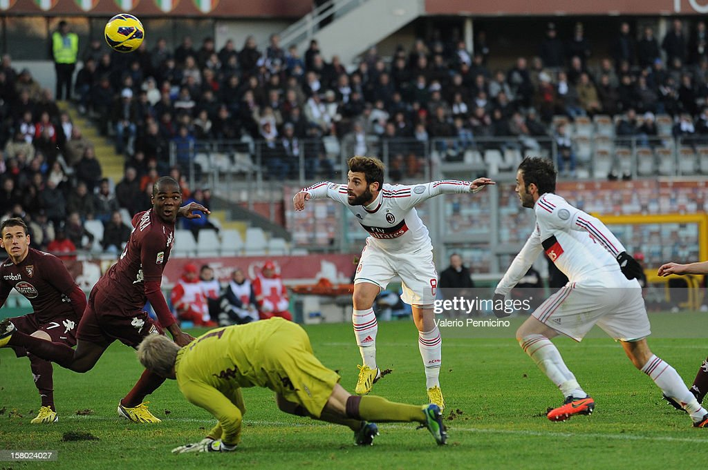 Antonio Nocerino (C) of AC Milan scores their second goal during the Serie A match between Torino FC and AC Milan at Stadio Olimpico di Torino on December 9, 2012 in Turin, Italy.