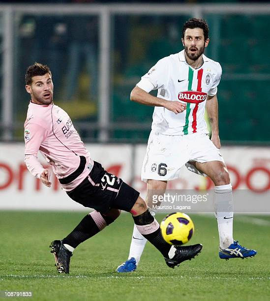 Antonio Nocerino of Palermo battles for the ball with Fabio Grosso of Juventus during the Serie A match between US Citta di Palermo and Juventus FC...