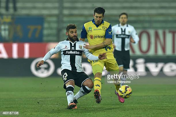 Antonio Nocerino of Parma FC competes with Mariano Izco of AC Chievo Verona during the Serie A match between Parma FC and AC Chievo Verona at Stadio...
