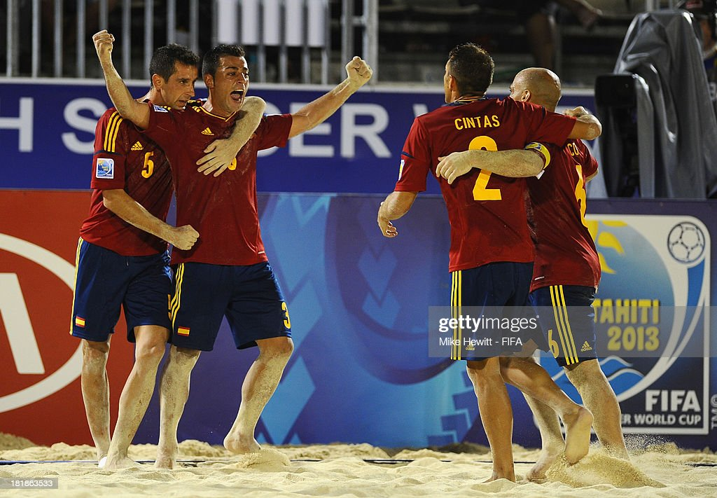 Antonio of Spain (2nd L) celebrates after scoring the winner during the FIFA Beach Soccer World Cup Tahiti 2013 Quarter Final match between Spain and El Salvador on at the Tahua To'ata Stadium on September 25, 2013 in Papeete, French Polynesia.