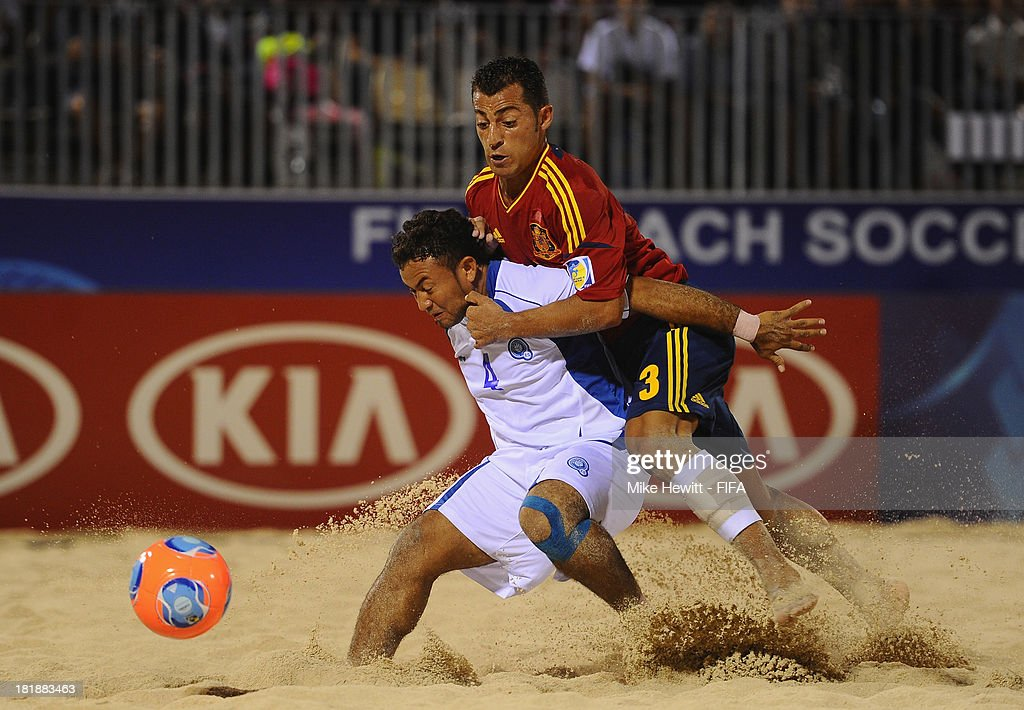 Antonio of Spain challenges Tomas Hernandez of El Salvador during the FIFA Beach Soccer World Cup Tahiti 2013 Quarter Final match between Spain and El Salvador on at the Tahua To'ata Stadium on September 25, 2013 in Papeete, French Polynesia.