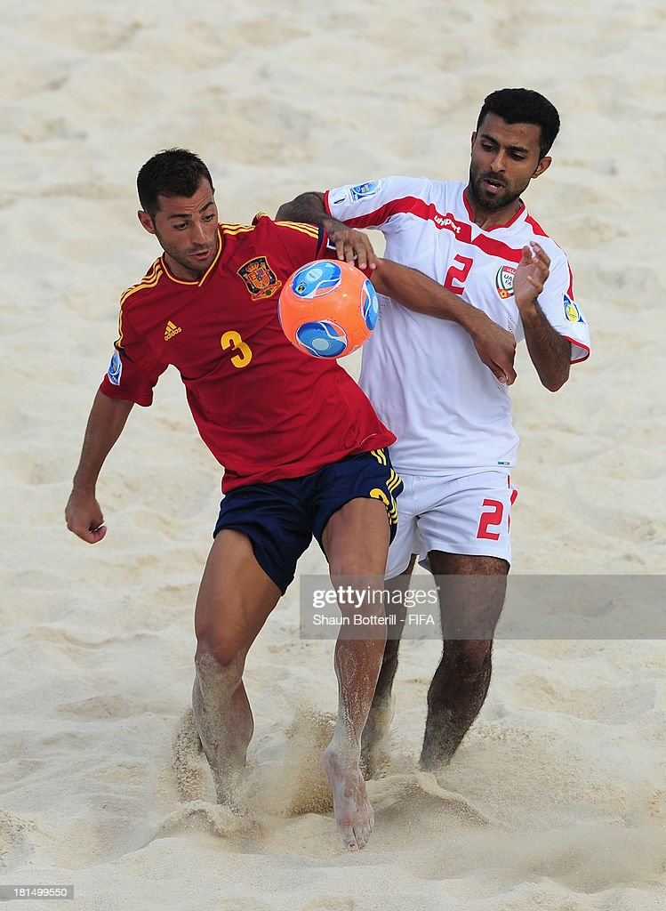 Antonio of Spain is challenged by Haitham Alkaabi of United Arab Emirates during the FIFA Beach Soccer World Cup Tahiti 2013 Group A match between United Arab Emirates and Spain at the Tahua To'ata stadium on September 21, 2013 in Papeete, French Polynesia.