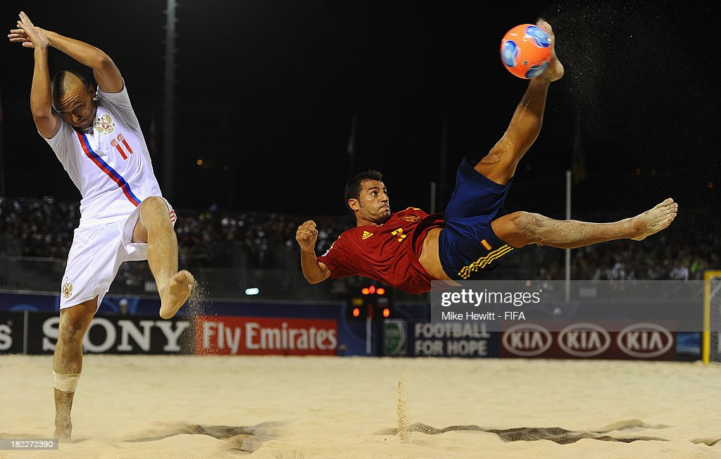 Antonio of Spain tries a bicycle kick as Egor Eremmev of Russia tries to block during the FIFA Beach Soccer World Cup Tahiti 2013 Final between Spain and Russiai at the Tahua To'ata Stadium on September 28, 2013 in Papeete, French Polynesia.