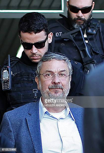 Antonio Palocci a former Brazilian finance minister and senior figure in the last two governments is pictured upon arriving under police escort at...