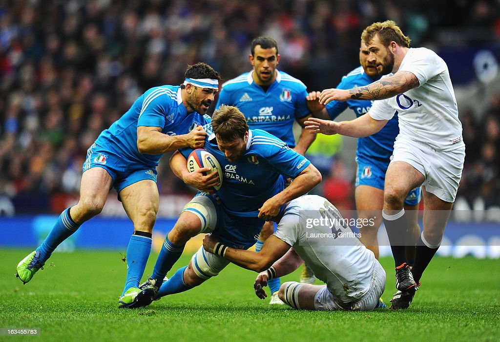 Antonio Pavanello of Italy is tackled by Tom Croft of England during the RBS Six Nations match England and Italy at Twickenham Stadium on March 10, 2013 in London, England.