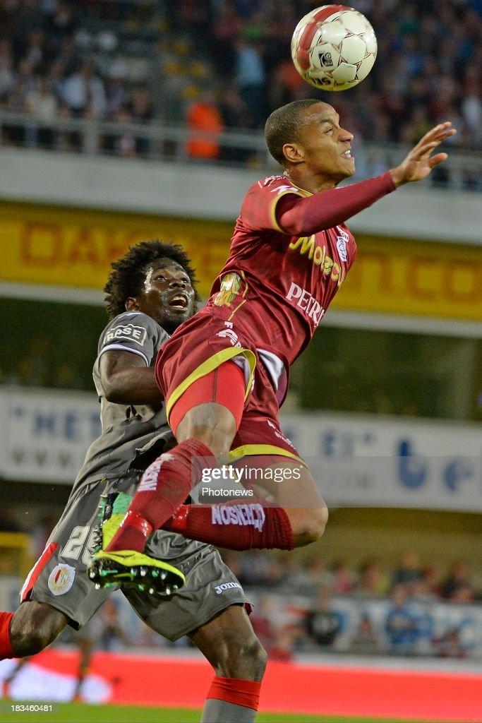 Antonio Pereira Dos Santos Kanu of Standard and Frederic Duplus of ZulteWaregem pictured during the Jupiler League match between Zulte Waregem and...