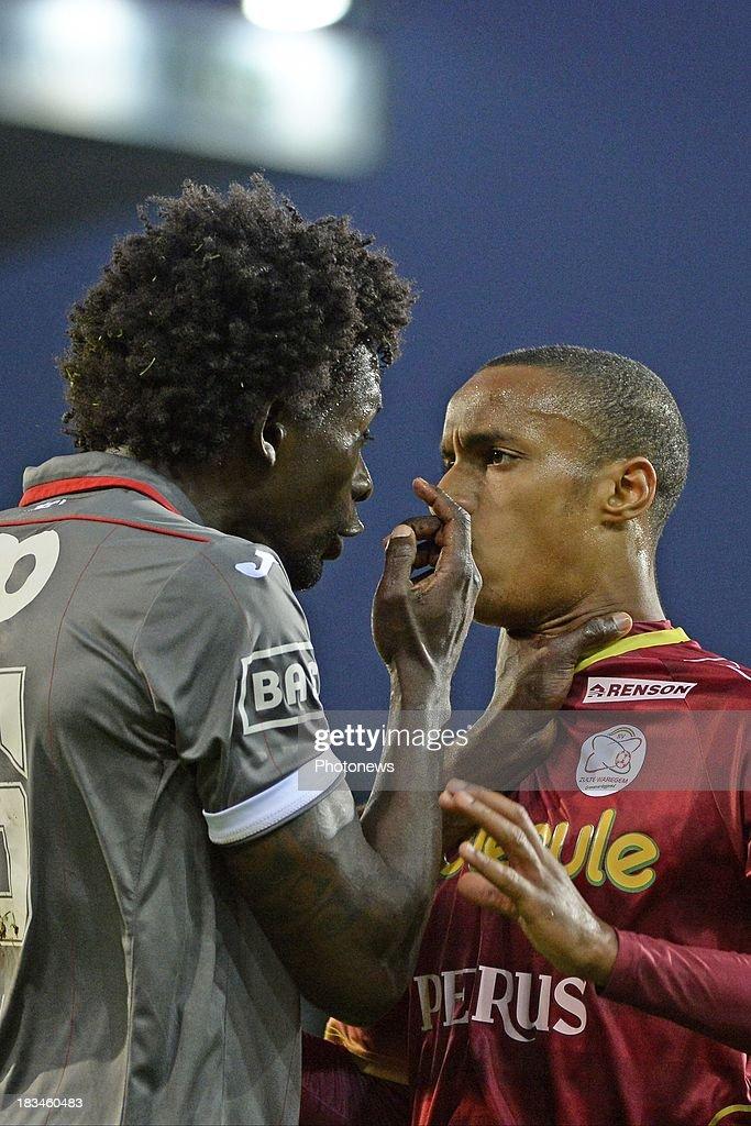 Antonio Pereira Dos Santos Kanu of Standard and Frederic Duplus of ZulteWaregem dispute during the Jupiler League match between Zulte Waregem and...
