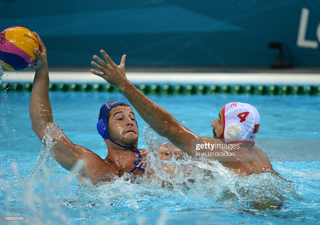 Antonio Petrovic of Montenegro is challenged by Vanja Udovicic of Serbia during the men's water polo bronze medal match Montenegro vs Serbia at the...