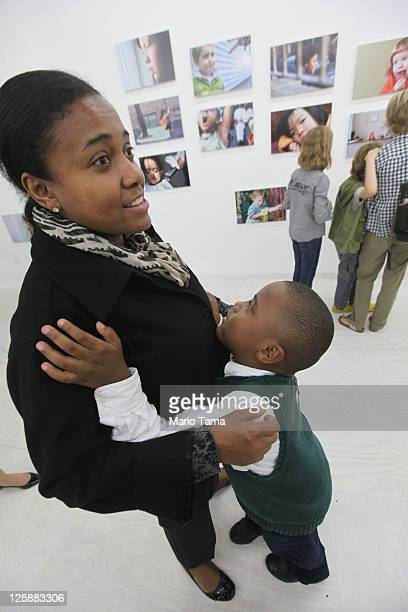 Antonio Price and Segia Andrade attend the opening exhibition of photographer Danny Goldfield's 'NYChildren' project at the grand opening of the...