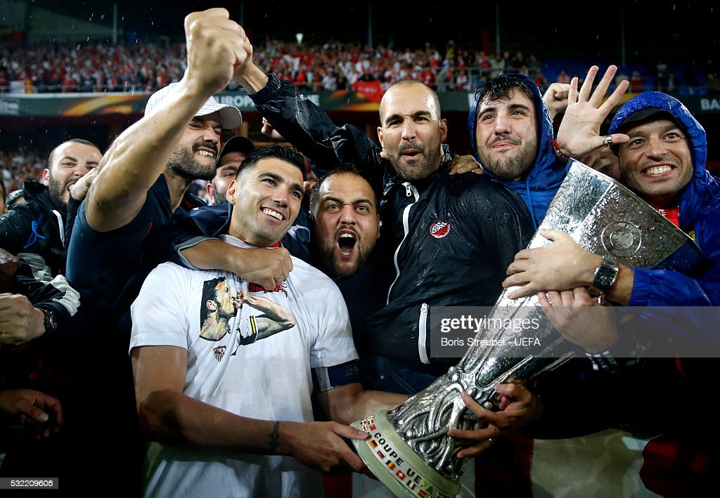 Antonio Reyes of Sevilla celebrates victory with the trophy and his fans after the UEFA Europa League Final match between Liverpool FC and Sevilla FC at St. Jakob-Park on May 18, 2016 in Basel, Switzerland.