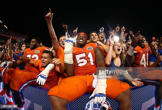 Antonio Riles of the Florida Gators celebrates in the stands with fans after defeating the Mississippi Rebels in the game on October 3 2015 in...