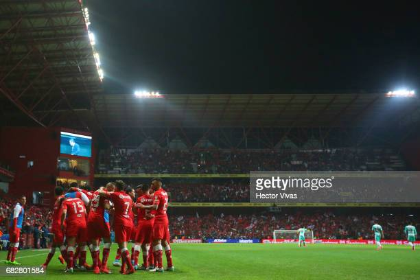 Antonio Rios of Toluca of Toluca celebrates with teammates after scoring the first goal of his team during the quarter finals second leg match...