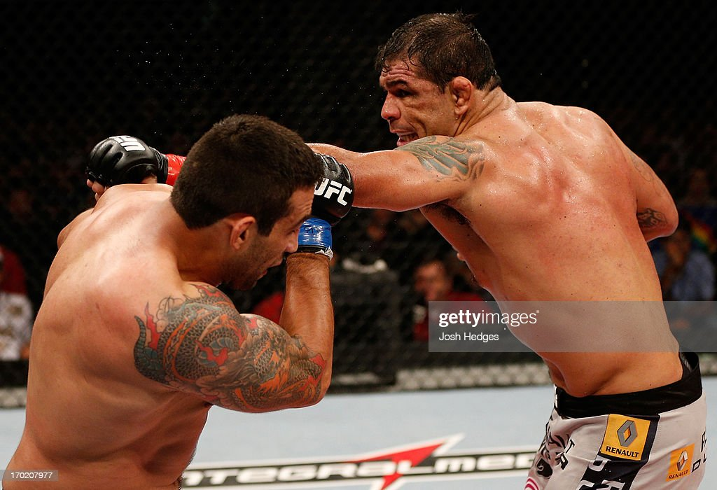 Antonio Rodrigo 'Minotauro' Nogueira punches <a gi-track='captionPersonalityLinkClicked' href=/galleries/search?phrase=Fabricio+Werdum&family=editorial&specificpeople=4254260 ng-click='$event.stopPropagation()'>Fabricio Werdum</a> in their heavyweight fight during the UFC on FUEL TV event at Paulo Sarasate Arena on June 8, 2013 in Fortaleza, Ceara, Brazil.