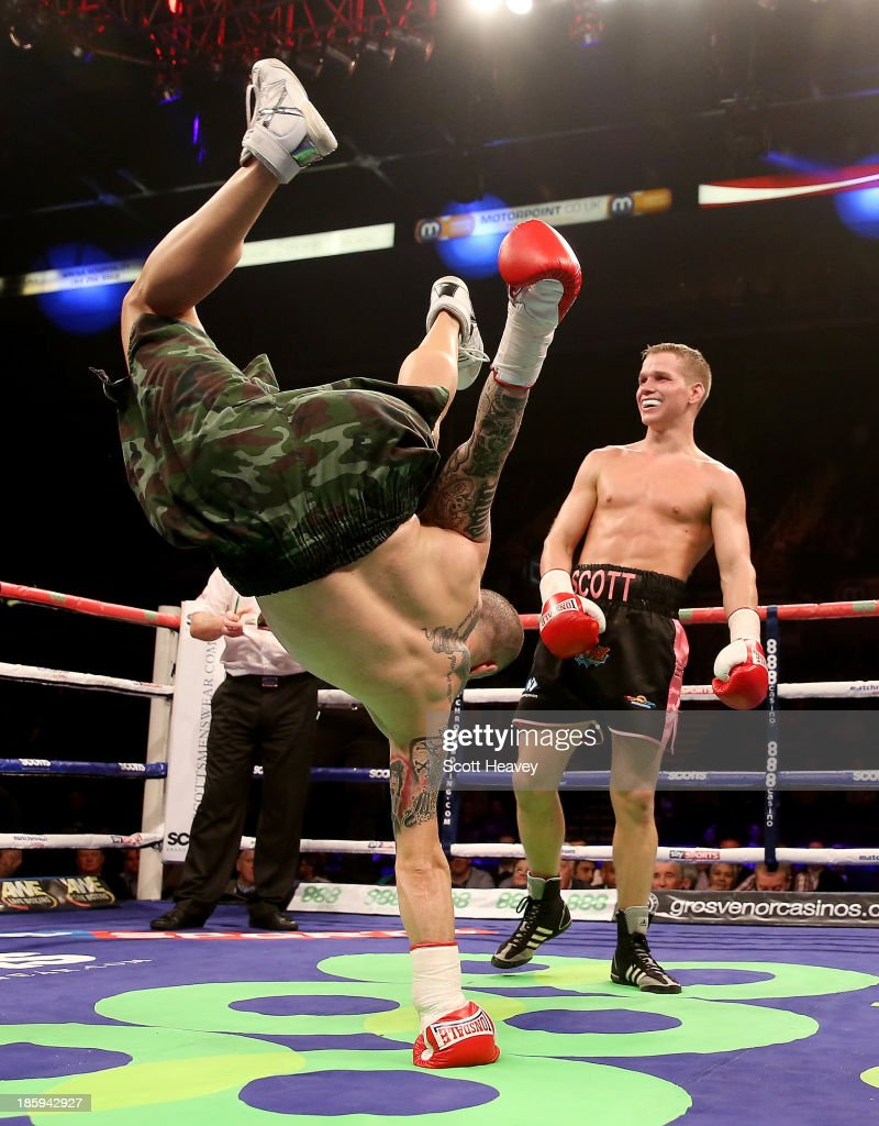 Antonio Rodriguez (L) dances in the ring as Scott Jenkins celebrates his victory during their Lightweight bout at Motorpoint Arena on October 26, 2013 in Sheffield, England.