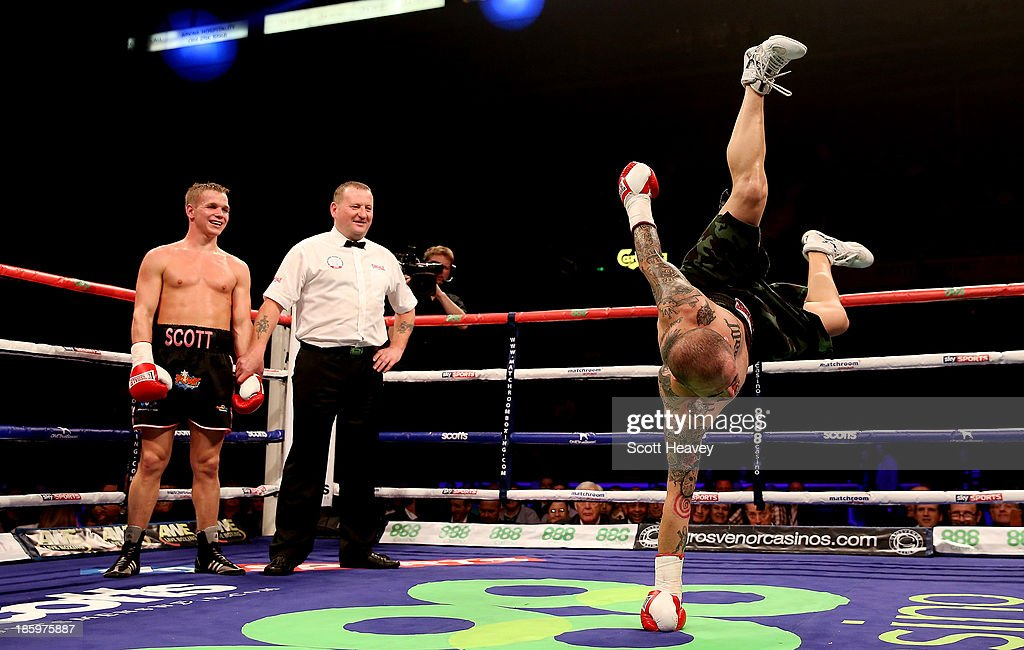 Antonio Rodriguez dances in the ring as Scott Jenkins celebrates his victory during their Lightweight bout at Motorpoint Arena on October 26, 2013 in Sheffield, England.