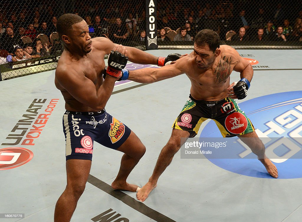 Antonio Rogerio Nogueira (right) punches Rashad Evans during their light heavyweight fight at UFC 156 on February 2, 2013 at the Mandalay Bay Events Center in Las Vegas, Nevada.