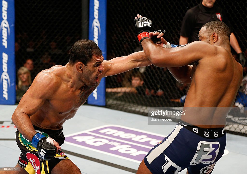 Antonio Rogerio Nogueira punches Rashad Evans during their light heavyweight fight at UFC 156 on February 2, 2013 at the Mandalay Bay Events Center in Las Vegas, Nevada.