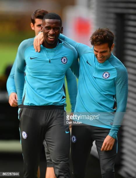 Antonio Rudiger and Cesc Fabregas joke during a Chelsea training session on the eve of their UEFA Champions League match against AS Roma at Chelsea...