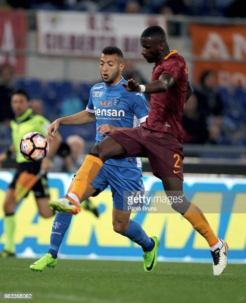 Antonio Rudiger of AS Roma competes for the ball with Omar El Kaddouri of Empoli FC during the Serie A match between AS Roma and Empoli FC at Stadio...