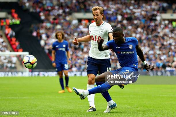 Antonio Rudiger of Chelsea clears the ball from Harry Kane of Tottenham Hotspur during the Premier League match between Tottenham Hotspur and Chelsea...