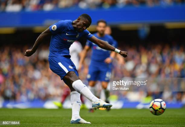 Antonio Rudiger of Chelsea has a shot on goal during the Premier League match between Chelsea and Burnley at Stamford Bridge on August 12 2017 in...