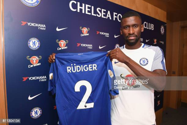 Antonio Rudiger of Chelsea holds his shirt after signing a 5 year contract at Chelsea Training Ground on July 9 2017 in Cobham England