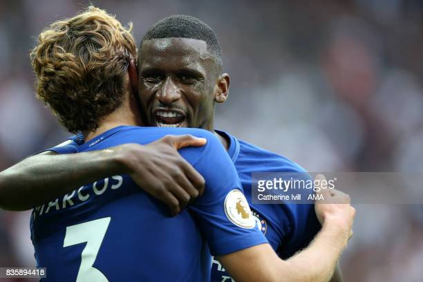 Antonio Rudiger of Chelsea hugs Marcos Alonso of Chelsea during the Premier League match between Tottenham Hotspur and Chelsea at Wembley Stadium on...