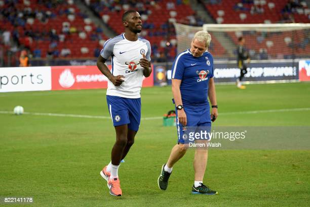 Antonio Rudiger of Chelsea warms up prior to the International Champions Cup match between Chelsea FC and FC Bayern Munich at National Stadium on...