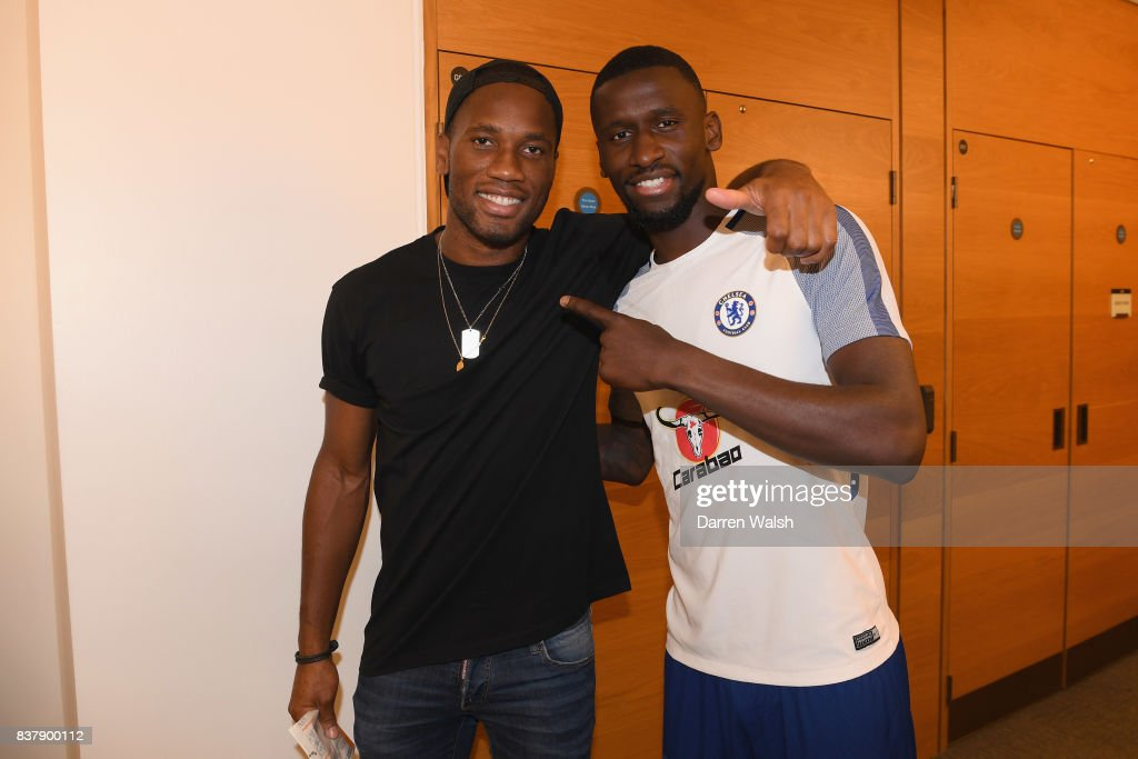 Antonio Rudiger of Chelsea with Ex Chelsea player Didier Drogba after a training session at Chelsea Training Ground on August 23, 2017 in Cobham, England.