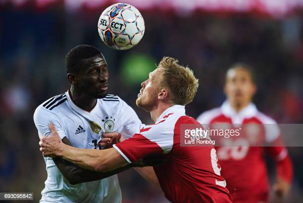 Antonio Rudiger of Germany and Nicolai Jorgensen of Denmark compete for the ball during the international friendly match between Denmark and Germany...