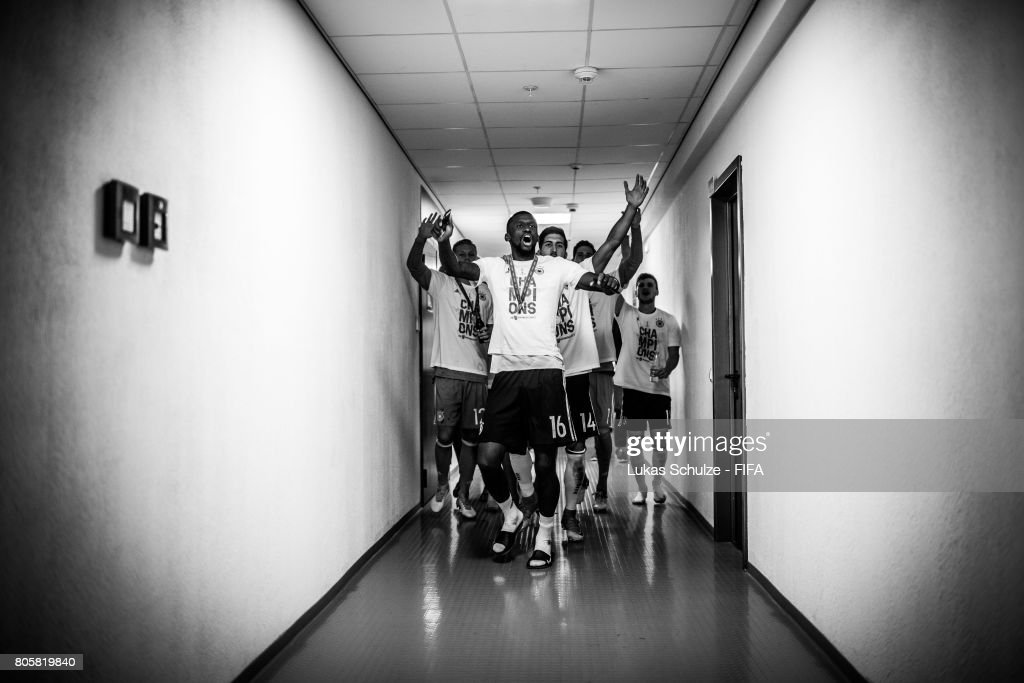 Antonio Ruediger (L) and Emre Can (R) of Germany and team mates celebrate in the players tunnel after winning the FIFA Confederations Cup final match between Chile and Germany at Saint Petersburg Stadium on July 2, 2017 in Saint Petersburg, Russia.