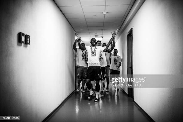 Antonio Ruediger and Emre Can of Germany and team mates celebrate in the players tunnel after winning the FIFA Confederations Cup final match between...