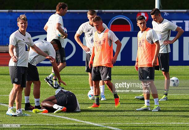 Antonio Ruediger is injured during a Germany training session ahead of the UEFA EURO 2016 at Ermitage Evian on June 7 2016 in EvianlesBains France...