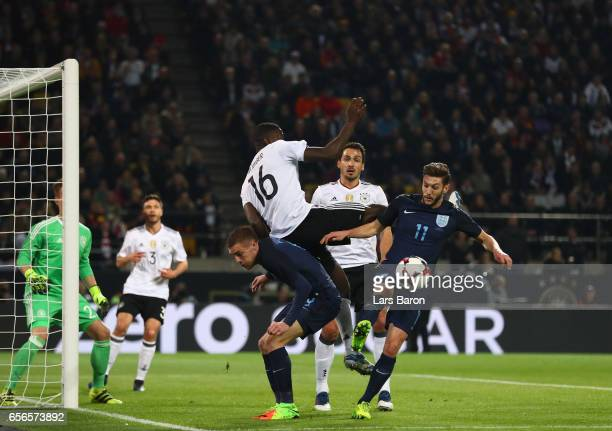Antonio Ruediger of Germany and Jamie Vardy of England and Adam Lallana of England battle for possession during the international friendly match...