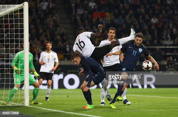 Antonio Ruediger of Germany and Jamie Vardy of England attempt to win a header during the international friendly match between Germany and England at...