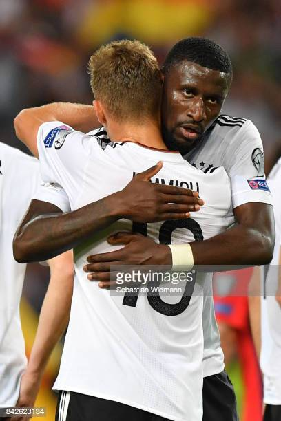 Antonio Ruediger of Germany and Joshua Kimmich of Germany embrace after the FIFA 2018 World Cup Qualifier between Germany and Norway at MercedesBenz...