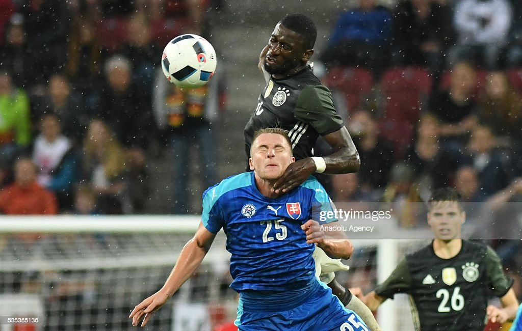 Antonio Ruediger of Germany and Milan Skriniar of Slovakia vie for the ball during the friendly football match between Germany and Slovakia at the WWK Arena in Augsburg, Germany on May 29, 2016.