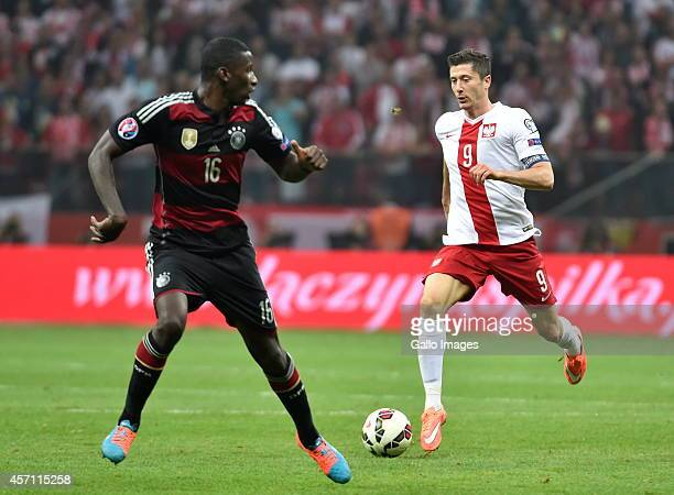 Antonio Ruediger of Germany and Robert Lewandowski of Poland during the UEFA Euro 2016 Qualifying Round match between Poland and Germany at the...