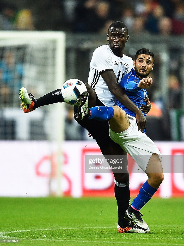 Antonio Ruediger of Germany challenges <a gi-track='captionPersonalityLinkClicked' href=/galleries/search?phrase=Lorenzo+Insigne&family=editorial&specificpeople=7486481 ng-click='$event.stopPropagation()'>Lorenzo Insigne</a> of Italy during the International Friendly match between Germany and Italy at Allianz Arena on March 29, 2016 in Munich, Germany.