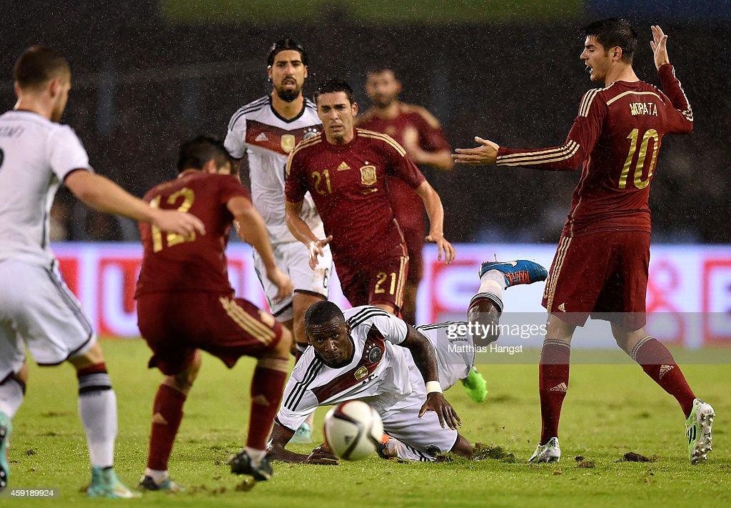 Antonio Ruediger of Germany falls to the floor next to Alvaro Morata of Spain during the International Friendly match between Spain and Germany at...