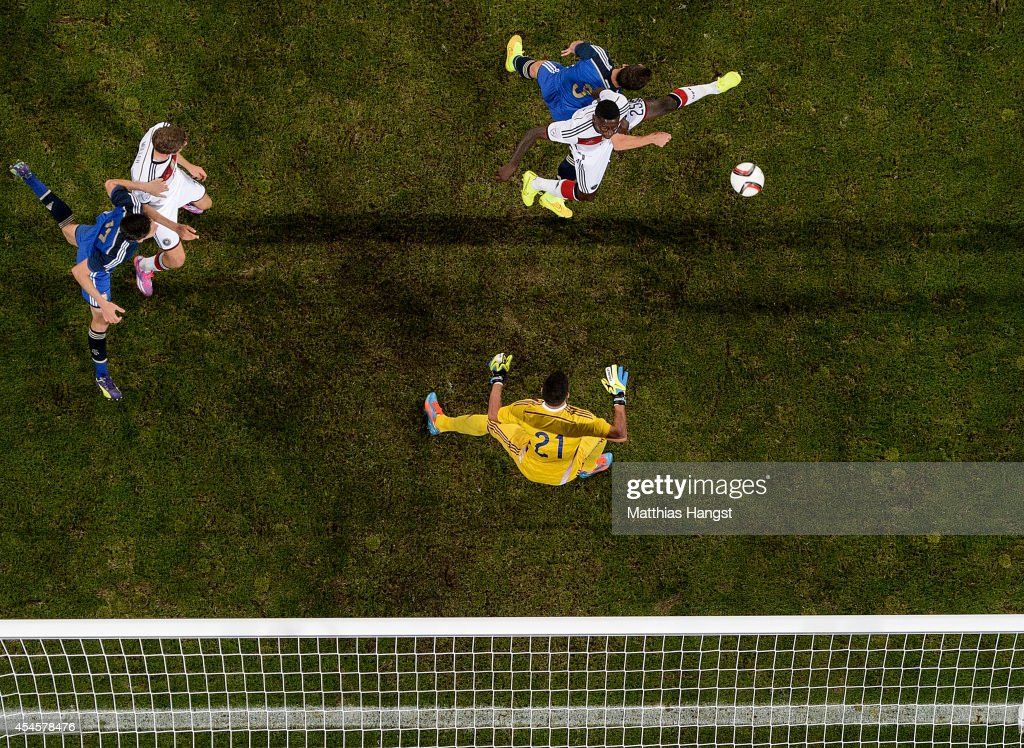 Antonio Ruediger of Germany jumps for a header with <a gi-track='captionPersonalityLinkClicked' href=/galleries/search?phrase=Hugo+Campagnaro&family=editorial&specificpeople=4530287 ng-click='$event.stopPropagation()'>Hugo Campagnaro</a> of Argentina during the international friendly match between Germany and Argentina at Esprit-Arena on September 3, 2014 in Duesseldorf, Germany.