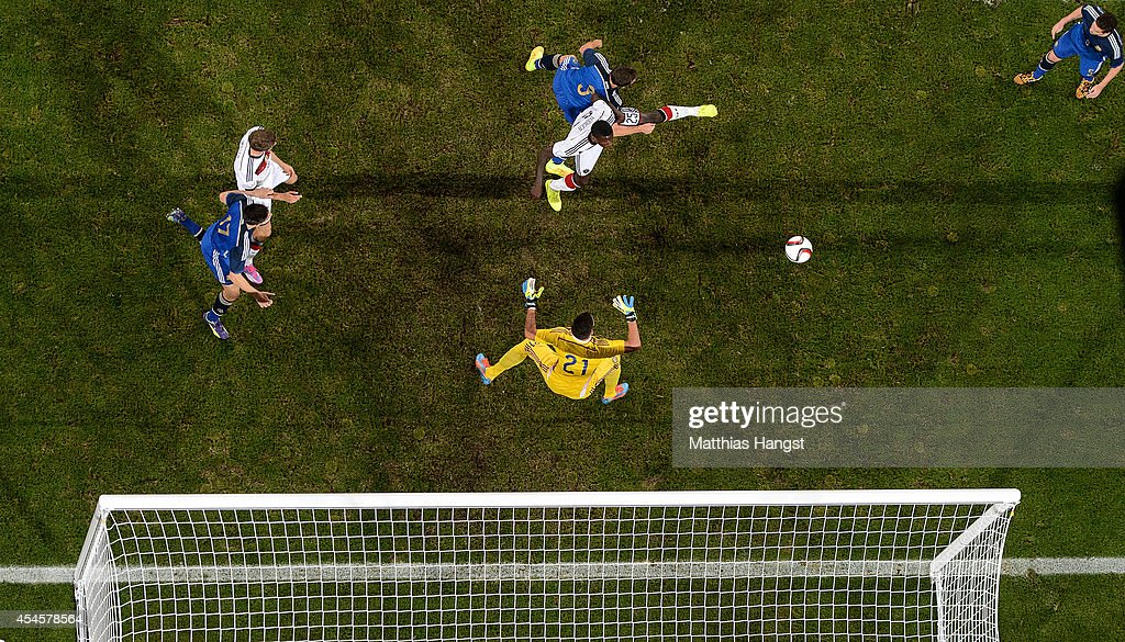 Antonio Ruediger of Germany jumps for a header with Hugo Campagnaro of Argentina during the international friendly match between Germany and Argentina at Esprit-Arena on September 3, 2014 in Duesseldorf, Germany.