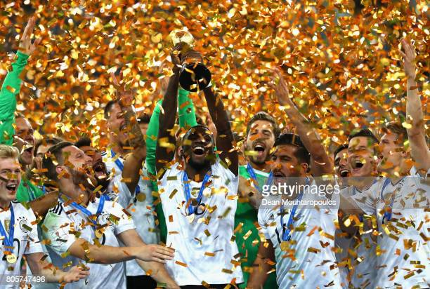 Antonio Ruediger of Germany lifts the FIFA Confederations Cup trophy after the FIFA Confederations Cup Russia 2017 Final between Chile and Germany at...